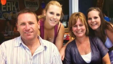 Tony Jenkins with his wife, Sharon and daughters Kim (left) and Cidney (right).
