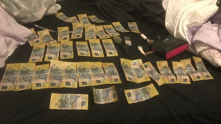 Cash that was seized by police during a search in Rivett on June 5.