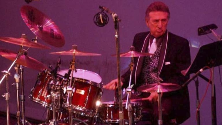 Elvis Presley drummer DJ Fontana performs at the 50th anniversary celebration concert of Elvis Presley's first performance at the Louisiana Hayride in Sherveport, Louisiana.