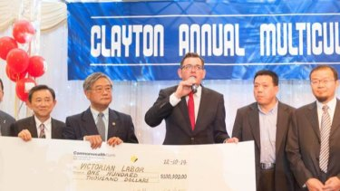 Daniel Andrews accepts a cheque for the Victorian Labor Party in 2014.