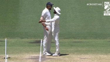 Heated exchange: Ishant Sharma and Ravi Jadeja.