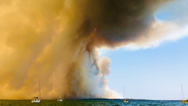 The Woodgate bushfire, south of Bundaberg. Picture taken from the safety of the other side of the Isis River.