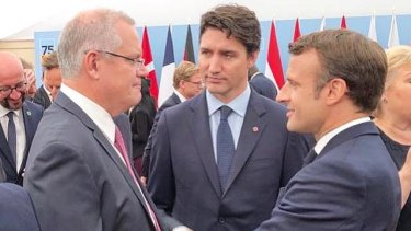 Prime Minister Scott Morrison speaks to Canadian Prime Minister Justin Trudeau (centre) and French President Emmanuel Macron (right) in Portsmouth.