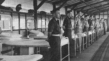 Patients lined up for inspection in mosquito proof ward, 1945.