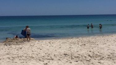 People taking a dip at Leighton beach.