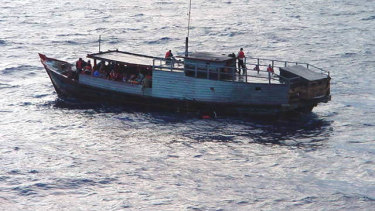 Asylum seekers rescued from a sinking boat.