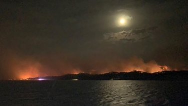 Moreton Island off Brisbane burns on Saturday night.