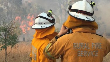 Firefighters had all of the state's bushfires contained on Saturday, but winds could help the flames break out.