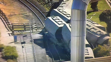 Two people have been taken to hospital after a driverless train derailed in Devonport.