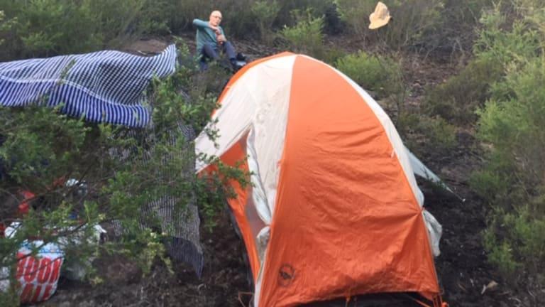 William McCarthy at a campsite he andFrancisca Boterhoven De Haan set up in Morton National Park.