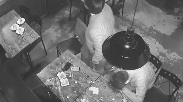 CCTV footage shows a patron asleep at a table inside the restaurant.