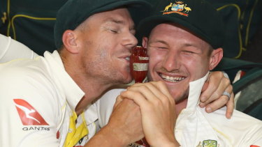 Happy times: David Warner and Cameron Bancroft celebrate winning the Ashes.