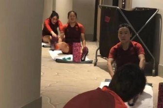 The Chinese soccer team goes through their paces in the corridors of the Westin in Brisbane.