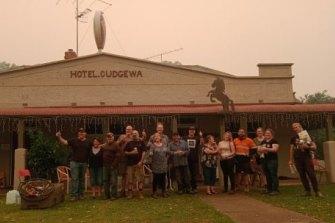 Locals outside the Cudgewa pub during last summer's bushfires.