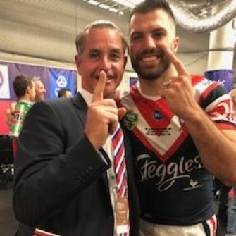 Coach Whisperer Bradley Charles Stubbs with James Tedesco after the Roosters' grand final win in 2018.