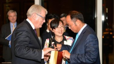 Huang with then Trade Minister Andrew Robb in Hong Kong in 2014, the year the China free trade agreement was signed.