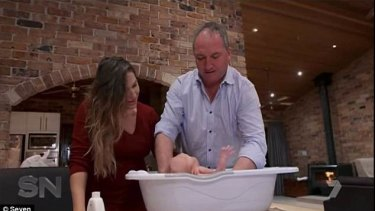 Joyce and partner Campion giving their son Sebastian a bath on Channel Seven's Sunday Night earlier this year.