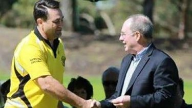 Bradley Edwards shaking hands with former WA Labor leader Eric Ripper during a presentation for his 10 years' service at Kewdale Little Athletics Club in 2013.