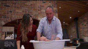 Joyce and partner Vikki Campion giving their son Sebastian a bath for the cameras.
