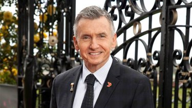 Switching horses: Channel Seven's Bruce McAvaney at Flemington on Derby Day.