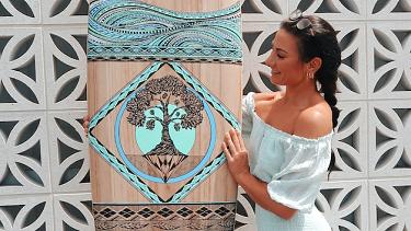 Creative inspiration … Jess Lambert with one of her distinct artworks.