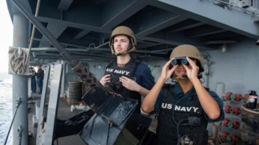 US sailors search for surface contacts during a Strait of Hormuz transit in 2019.