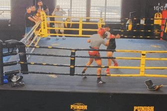 Boxer Justis Huni hits the canvas during sparring in January.