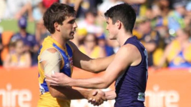 Andrew Gaff and Andrew Brayshaw shakes hands in a 2019 pre-season match ... their first clash since the incident.