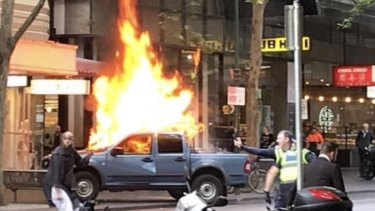 The blazing vehicle on Bourke Street.
