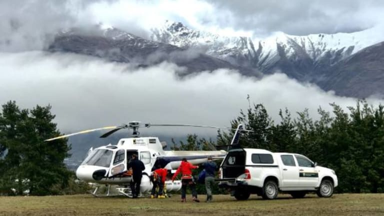 Helicopters on the ground in Wanaka waiting for the weather to clear.