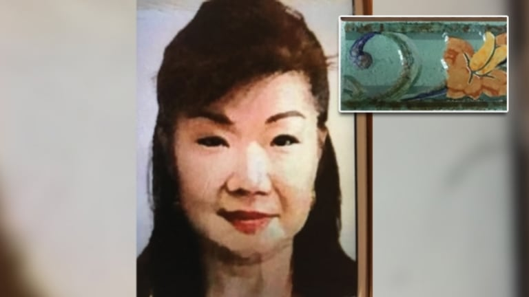 Annabelle Chen and one of the tiles found inside the suitcase dropped at the Fremantle Traffic Bridge.