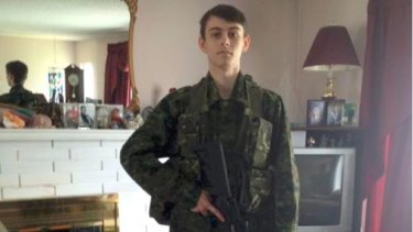 A picture from a Steam account thought to be owned by Bryer Schmegelsky showing him in military gear with a weapon.