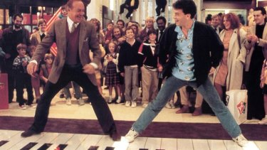 Robert Loggia and Tom Hanks in a classic scene from Penny Marshall's Big.