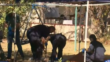 Police excavate a backyard in the southern Queensland town of Chinchilla.