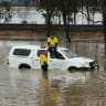 Drivers plucked from car roofs as Hume floods in drenched state