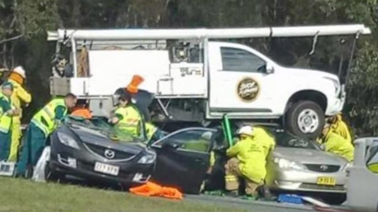 The ute landed on cars on Pumicestone Road after coming down the off-ramp alongside the Caboolture Bypass.