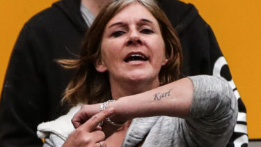 One of Karl Hague's supporters shows off her tattoo of his name.