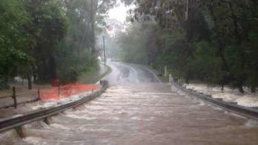 Rainfall over in Queensland has flooded roadway.