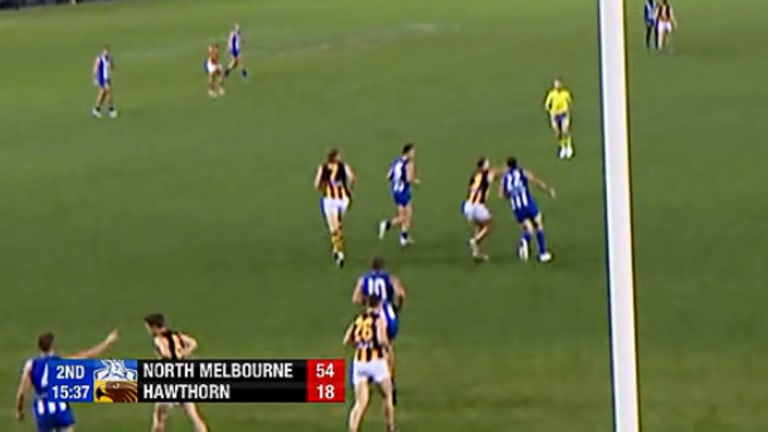 Screen grab of footage showing Hawthorn star Tom Mitchell clips Todd Goldstein behind the play.