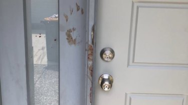 Blood was smeared on the door with hand prints after a teenage girl was stabbed multiple times in a Wynnum home.