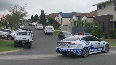 The 82-year-old woman was already dead when officers arrived at the Varsity Lakes property on the Gold Coast.