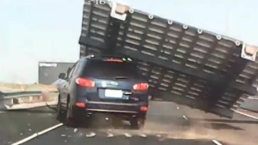 An image from dashcam footage of Nella Letteri's car being crushed by a falling sign.