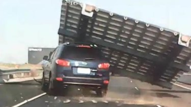 A dash-cam image of Nella Letteri's car being crushed by a falling sign.