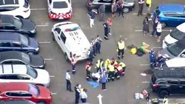 A 35-year-old woman is in critical condition after she got trapped beneath her car outside a primary school in Quakers Hill.