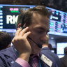 Wall Street hits new record highs as US economy stronger than expected