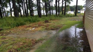 US Marine, 1st Sergeant Scott Johnson and wife Lindsey's flooded Lendlease-managed home in North Carolina.
