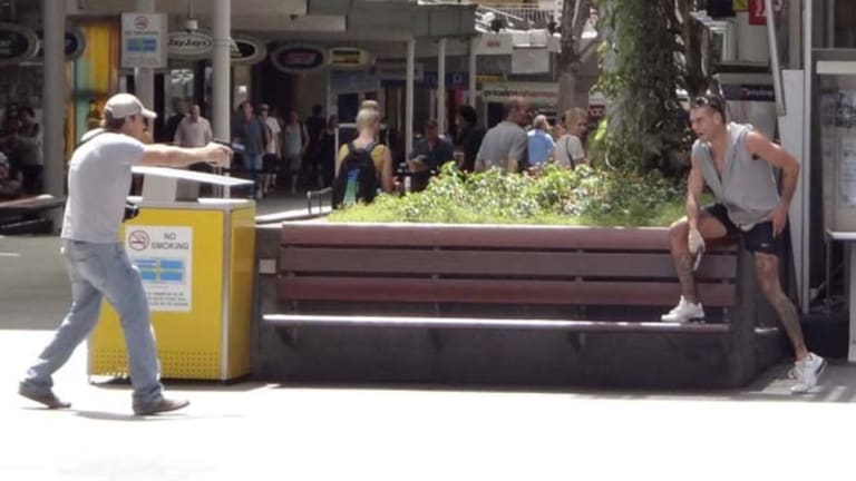Lee Matthew Hillier, pictured being confronted by an armed police officer, locked down the Queen Street Mall in 2013.