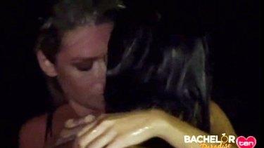 Megan Marx kisses mystery brunette on the Bachelor in Paradise.