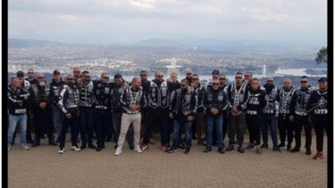 Nomads OMCG members pose for pictures on Mount Ainslie during a meeting in Canberra in August.