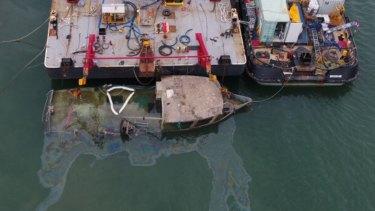 Thepartially-raised fishing trawler Dianne at the Port of Bundaberg.